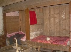 This pair of beds takes up the whole of one side of the main living-room / kitchen in a Scottish Highlands cottage. And, yes, the second one is even shorter than the first - presumably for children, since even the main bed is small by modern standards. Scotland has a strong tradition of box beds, which are more part of the architecture than pieces of furniture.