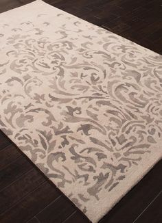 This hand-tufted rug illustrates lux patterns and details inspired by classic themes from around the world.  Timeless, by Jennifer Adams blends eternal traditions with today's lifestyles. Vintage and livable with comfortable elegance, this transitional rug is suitable for any décor. Shown here in Pumice Stone and Brindle.