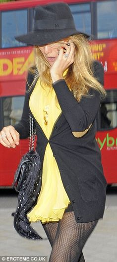 Stylish as usual: The former Gossip Girl actress looked glam in her yellow tunic and fedora hat