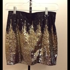 Sequin Skirt! Barely worn! A barely worn sequin party skirt. I don't wear it anymore so I hope you have fun wearing it! Size 6, fits like a 2/4.  feel free to make an offer!  Divided Skirts
