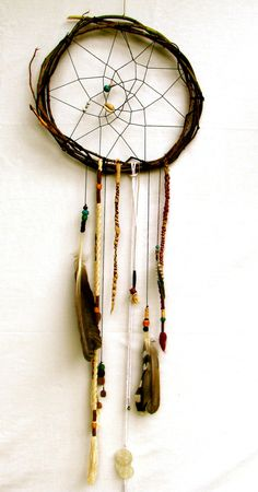 This handmade dream catcher measures 15 across, 44 long. One of a kind.    The ring is made with maple branches, the beautiful details are created