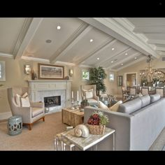 Love the ceiling and recessed lighting in this space. The furniture and decor colors promote a light and airy feel without sacrificing the cozy feeling every home should have. Lets not forget that beautiful chandelier in the dining room!... - Interior Design Ideas, Interior Decor and Designs, Home Design Inspiration, Room Design Ideas, Interior Decorating, Furniture And Accessories