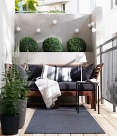 Simplicity is beauty. Make use of minimalist designs to make your balcony look more spacious but at the same time comfortable and modern. The black couch and humble throw pillows complete the overall relaxing vibe of the balcony.