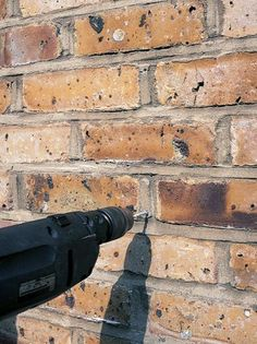 Use Power Drill with Masonry Bit to Secure Hanger