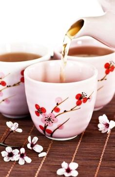 Photo about Pouring green tea into cups with cherry blossom design. Image of brew, green, brewed - 10263267 Green Tea Vs Coffee, Fancy Tea Cups, Tee Set, Discount Coffee, Tea Benefits, Chinese Tea, How To Make Tea, Chocolate Pots, Tea Recipes