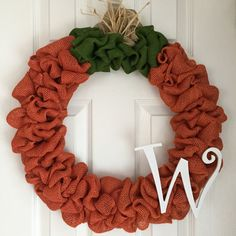Burlap pumpkin wreath made on a 16 wire frame. The finished product is about 20 in diameter.  Each wreath is handmade and may differ slightly from the example shown in the photo. I make every effort to ensure each wreath is full and even.  All my wreaths are made to order so please allow 1-2 weeks of processing time. Thank you for your interest in Adore Your Door