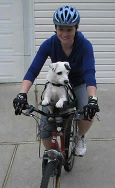 Am looking for a pet seat for my bike. Wondering how this works on a woman's bike? Will I be able to get on and off easily?