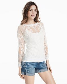 "We reimagined the classic sweatshirt silhouette with allover mesh lace. Throw it on over a white cami and your favorite pair of jeans for a fresh off-the-clock look.   Long-sleeve white mesh sweatshirt Ribbed crew neck, cuffs and hem Approx. 24 1/2"" from shoulder Polyester/cotton. Machine wash cold. Imported"