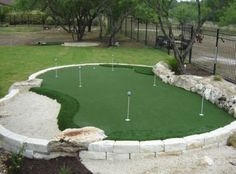 Unique green situated in raised stone barrier, integrating natural stone features on border. Features multiple holes and approaches, plus full sand trap. Home Putting Green, Outdoor Putting Green, Artificial Putting Green, Outdoor Projects, Garden Projects, Backyard Projects, Diy Projects, Indoor Outdoor, Outdoor Living