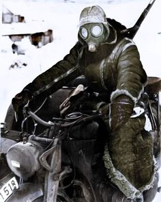 the_ww2_memoirs A German dispatch rider with his motorcycle outside of Moscow, Winter, 1941/1942. A gas mask has been adapted as a face protector against temperatures as low as -40°C while his body is wrapped in sheepskin. The winter of 1941/1942 was one of the first for the Wehrmacht and in Russian history. During the Germans initial assault they were making good headway but were slowed down after their Panzer force had to be diverted south to assist Army Group South. Then in October they…