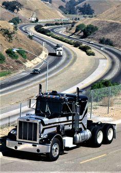 A classic Peterbilt Model 359 sits near an interstate during a 1976 photo shoot. Big Rig Trucks, Semi Trucks, Cool Trucks, Peterbilt 359, Freightliner Trucks, Semi Trailer Truck, Model Truck Kits, Truck Transport, Heavy Construction Equipment