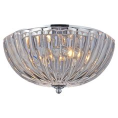 Lend a glamorous touch to your dining room or foyer with this elegant flush mount, showcasing a ribbed glass shade and sparkling silver finish.