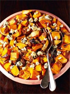 BUTTERNUT SQUASH WITH PECANS AND BLUE CHEESE This has many strings to its bow: it serves as a vegetarian alternative to the Holiday turkey; it gussies up a plate of cold leftover turkey; it adds the right balance of mellow warmth and tang to any plain wintry dish; it is a good whole meal on days when you just feel fleshed-out.