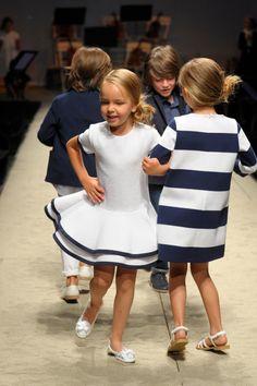 Pitti Bimbo @Il Gufo spring summer 2014 catwalk. White dress with blue trims and jersey dress with blue and white stripes. #ilgufo #ilgufosummercolors #springsummer2014 #pittibimbo #SS14 #children #kids #childrenwear #kidswear #girls