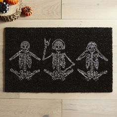 Our glittery skeleton doormat delivers a fun message to your guests: See no evil, speak no evil, but always rock on.