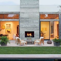 10 Good Clever Tips: Fireplace Christmas Photoshoot faux concrete fireplace.Cozy Fireplace Architectural Digest fireplace with tv above and windows.Fireplace With Tv Above Built Ins. House Design, Concrete Fireplace, House Exterior, Fireplace Design, Outdoor Fireplace, Outdoor Space Design, Los Angeles Homes, Indoor Outdoor Fireplaces, Architectural Digest