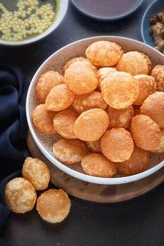 Delicious Crisp Fried puffed golgappa puri (pani puri) served in a large bowl. Golgappa pani, filling and sweet chutney on the side. Puri Recipes, Veg Recipes, Kitchen Recipes, Indian Food Recipes, Vegetarian Recipes, Snack Recipes, Cooking Recipes, Recipies, Savoury Recipes