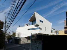 Hose N by Masaya Yoshimura.  This is a two-generation family housing situated on high ground in Tokyo metropolitan area. The housing is composed of two interlocked volumes of A-House and B-House. http://www.archello.com/en/project/n-house-6