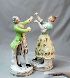 "Occupied Japan Collection Porcelain couple figurines 6 1/2"" tall each The lady has Maruyama MIOJ mark, the gentleman just has Maruyama mark. Are they dancing? Shoko Tanaka Collection"