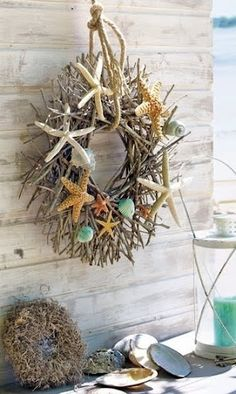 Twig Wreath from your local craft or floral store. Give it a nautical touch by hanging it off a rope, and decorate it with Beach Finds that reflect the season. Shells in rich tones of orange and browns for example. Or paint the shells.