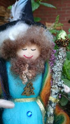 Check out this item in my Etsy shop https://www.etsy.com/uk/listing/461652968/rainbow-wizard-wool-felted-faerie