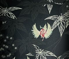 Grove Garden Wallpaper Black wallpaper with pale gold leaf design and colourful hummingbirds dancing between the leaves