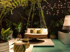Put A Swing In Your Living Room  - go to the website to see the many swings that are featured.  My favorite is this one - imagine lounging by the pool, swaying slightly with the breeze, listening to the pool sounds.. | Home + Garden | PureWow National