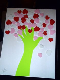 Heart tree using hand print and foam heart stickers.