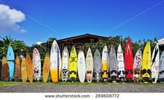 PAIA, HI -30 MARCH 2015- Editorial: Colorful surfboards are lined up in the streets of Maui. Hawaii is the birthplace of modern surfing and home to the world's major big wave surfing competitions.