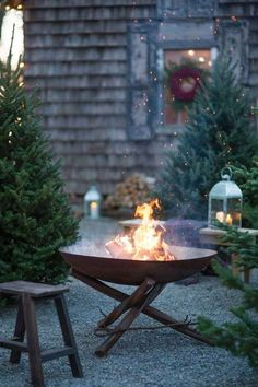 a great idea. Perhaps decorate the pergola and set up a table and a couple of chairs to sit by the fire on Christmas eve.Such a great idea. Perhaps decorate the pergola and set up a table and a couple of chairs to sit by the fire on Christmas eve. Outdoor Fire, Outdoor Living, Outdoor Trees, Party Outdoor, Outdoor Pergola, Outdoor Decorations, Fire Pit Designs, Outdoor Kitchen Design, Winter Garden