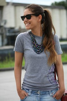 How obvious! Grey t-shirt, faded boyfriend jeans are a really casual outfit. But! You add the cute black sling back pumps AND the gorgeous STATEMENT NECKLACE, she is looking tres' chic. It's the Necklace!