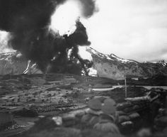 U.S. forces watch a massive fireball rise above Dutch Harbor, Alaska after a Japanese air strike in June of 1942. (U.S. Navy)