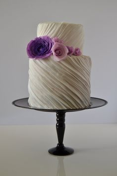 Diagonal fondant ribbons make for a textured, layered #wedding #cake.