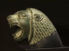Achaemenid lion head Persian- achaemenid, 5th- 4 th century BC. Material: hollow bronze. Dimensions: 16 cm high. Hollow-cast bronze lion's head in the form of a snarling lion with ferociously bared jaws, his mane boldly and finely delineated. Provided of Oxford University metallographic test for authenticate the bronze. Provenance: private English collection. Previously, Japanese private collection,