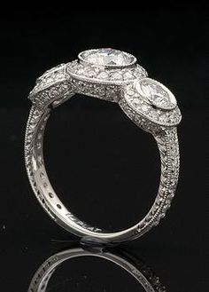 A different take on the classic 3-stone ring.  LOVE!