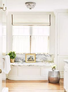 Airy white and marble master bathroom with cafe curtains and a Roman shade for layered window treatments. Source by homeglowdesign Curtains Bathroom Window Treatments, Bathroom Windows, Bathroom Curtains, Cafe Curtains Kitchen, Curtains Inside Window Frame, Hanging Curtains, Window Curtains, Small Curtains, Striped Curtains