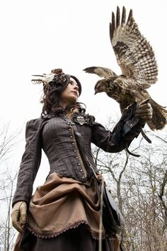 I'd make (at least) the skirt in a plaid!  She looks more like a highlander than steampunk & I like that!
