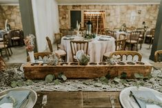 Wooden Candle Holder, Macrame Runner, Milk Jar, Silver Charger, Dusty Blue Napkins  P.C. Misty Mclendon Photography Wooden Candle Holders, S'mores Bar, Tree Lighting, Twinkle Lights, Dusty Blue, Wedding Venues, Table Settings, Candles, Table Decorations