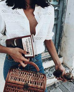 French Inspired Stye: White blouse, high waist denim, Vintage style bag.