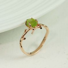 """pink gold rough peridot ring Approx. measurement: 3/8"""" x 3/8"""" Material: pink gold plated sterling silver, rough peridot Item #: 13259"""