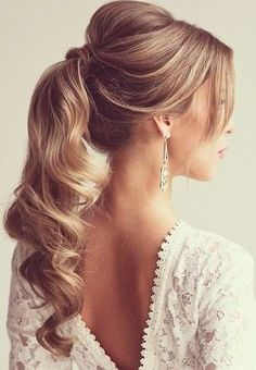 Blond + Curls + Ponytail + Wrapped With End Part + Bouffant