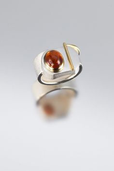 ring - Sterling silver, 18kt yellow gold, hessonite garnet  by Janis Kerman Design