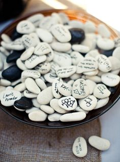 Sign in with Rocks... write best wishes to be saved in a vase... also great idea to write favorite short quotes or things that make you smile... to set on family room coffee table and browse through on days you need a boost or prompt great discussions...
