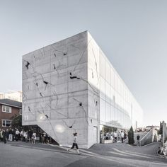 Cracks in the concrete facade of this office block in Aarhus by Danish architecture practice Sleth provide glimpses of the building's illuminated interior.