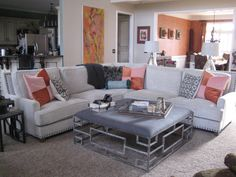 Accessories really help pull your rooms together with a splash of color, as it does in this Family and Dining Room. Velvet square pillows using two different bright and pale rust fabrics tie into the Dining Room rust wall color and rust silk panel drapes. Pillows and drapery personally made by Julia Virga-Julia's Custom Windows & Renovations, Etc., LLC.  See more styles on our web site & SHOP-AT-HOME services. www.juliascustomwindows.com. Custom Windows, Fabulous Fabrics, Drapery, Color Splash, Home Office, Rust, Dining Room, Hardware, Velvet