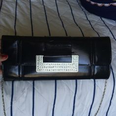 Faux black leather clutch- NWOT This clutch clips closed, has 1 pocket inside, and has a detachable long chain Bags Clutches & Wristlets