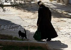 Monk and cat.