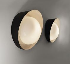 Charles Ramos; Lacquered Metal and Opaline Wall Lights for Luminalite, c1950.