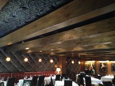 Puffed leather panels on wall. Stretched fabric acoustical panels on ceiling