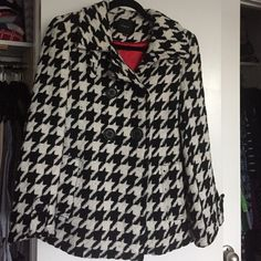 Express houndstooth pea coat Stylish houndstooth winter coat, looks get over everything, very warm, excellent condition. Fully lined red interior, this jacket never goes out of style. Slight pilling in the wool. Make an offer, will consider reasonable prices! Express Jackets & Coats Pea Coats